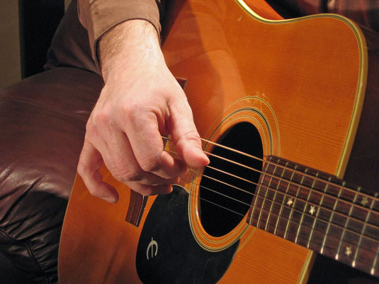 how to put finger ont guitar